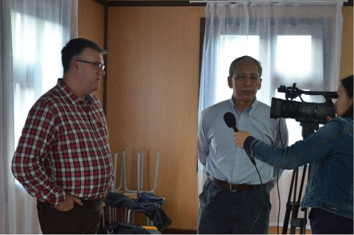 August 2015, Graham Hill, President & CEO and Yury Petrov, General Director, ZOA Prognoz, local television crew interview following bridge opening ceremony and blessing of Mangazeisky Project Chapel.